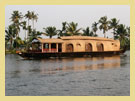 Alleppey - The House Boats in Kerala or the Kettuvallams (kettu means - tied with ropes , vallam means - boat) are large slow- moving floating structures with high load carrying capacity.